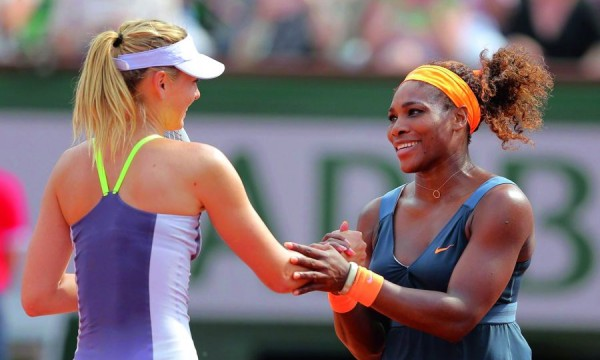 Williams of the U.S. shakes hands with Sharapova of Russia after winning the French Open tennis tournament in Paris